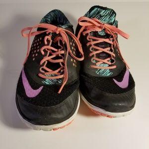 Nike Shoes - NIKE black multi colored tennis shoes